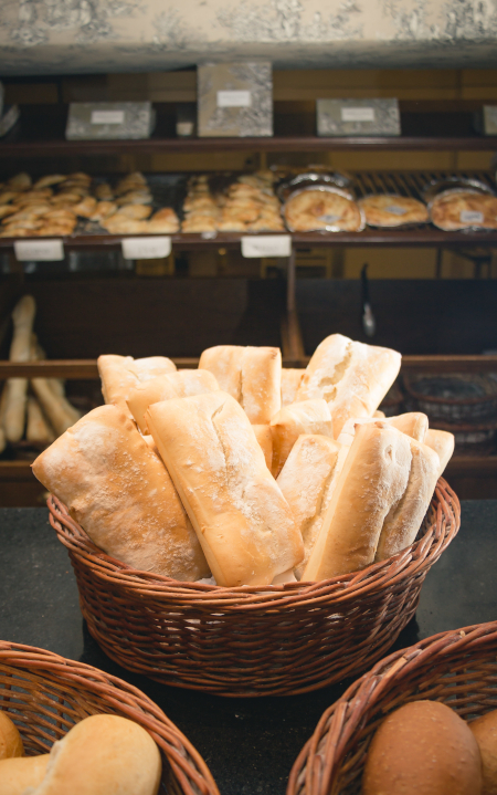 A vertical shot of pieces of bread in a basket in the shop